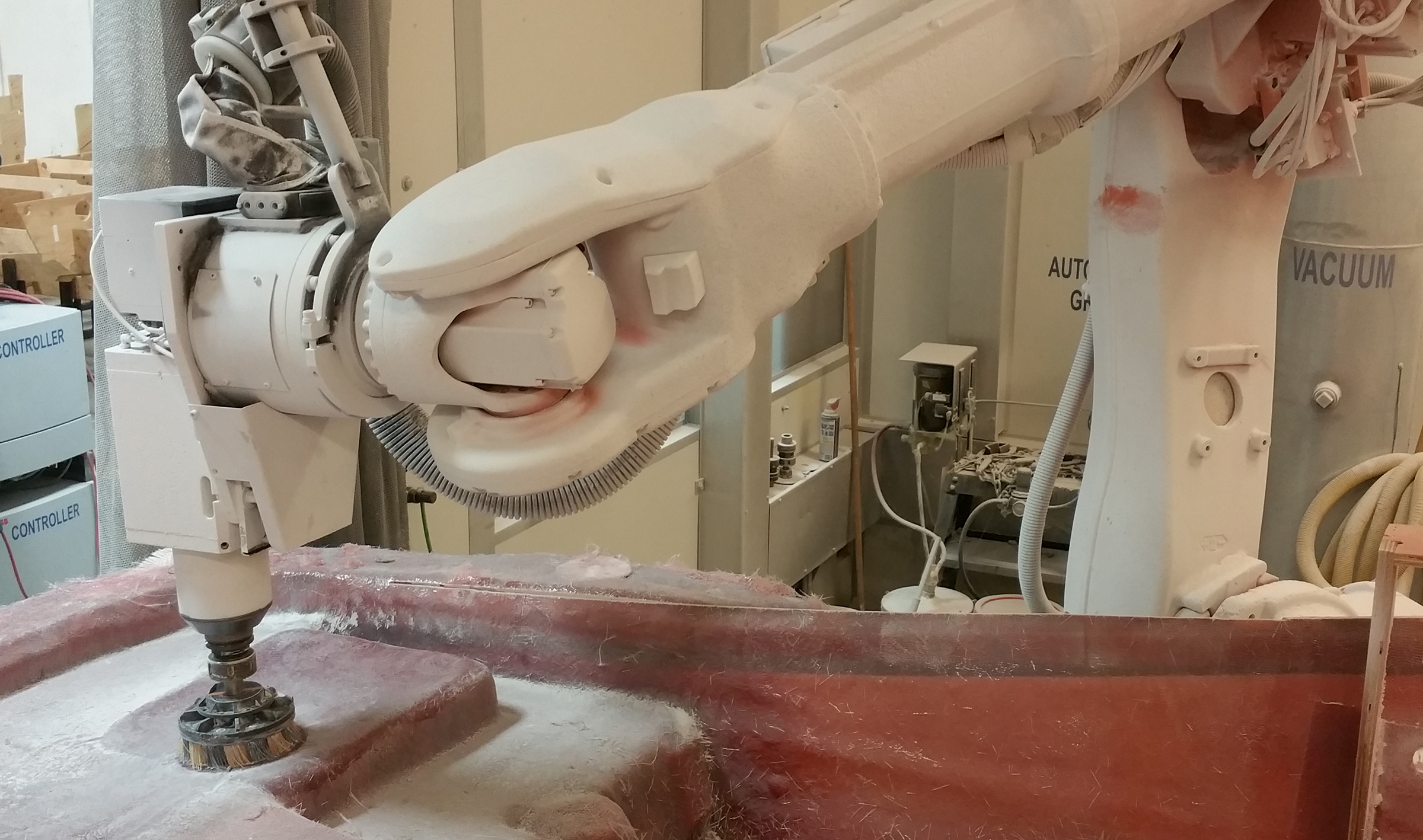 Robotic Hull Cutting, Sanding Speeds Luxury Boat Production ...